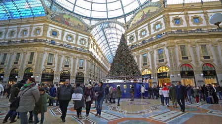 milan fashion : a view of the people walking during Christmas holidays in Vittorio Emanuele II gallery in Milan Stock Footage