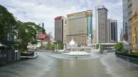 water feature : A view of Masjid Jamek Mosque and the Klang river in Kuala Lumpur, Malaysia
