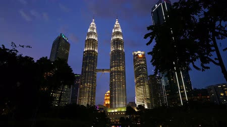 The KLCC park with a view of Petronas in the background by night in Kuala Lumpur, Malaysia