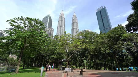 A view of the KLCC park with the Petronas twin towers on the background in Kuala Lumpur, Malaysia