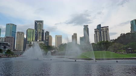 the fountains through the skyscrapers of the KLCC park in Kuala Lumpur, Malaysia