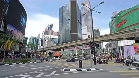 a city traffic panorama in the streets and the monorail train Kuala Lumpur, Malaysia Wideo
