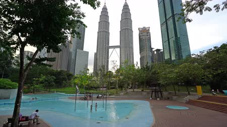 a pool among the waterfalls in the KLCC park in Kuala Lumpur, Malaysia Stok Video