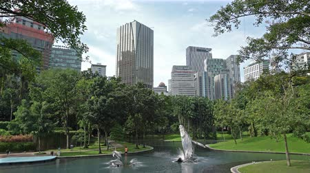 Kuala Lumpur, Malaysia. January 2019. The lake in KLCC park with the skyscrapers on the background.