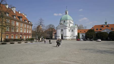 Warsaw, Poland. April, 2019. A view of New Town Market square with the Church of Saints Sacrament St. Kazimierz on the background