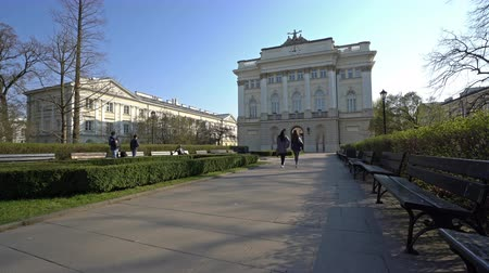 perspective : Warsaw, Poland. April 2019. Auditorium Minus in front of the university gardens Stock Footage
