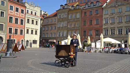 warszawa : Warsaw, Poland. April 2019. An organ player play in Rynek Starego square