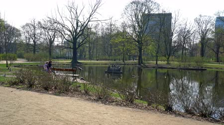 warszawa : Warsaw, Poland. April 2019. Sculpture on the water at the pond in the Krasinskich garden in spring