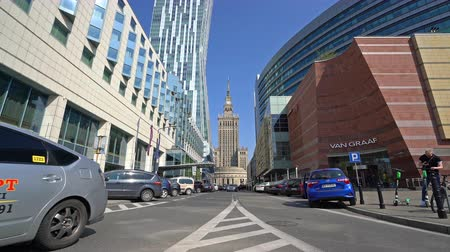 warszawa : Warsaw, Poland. April 2019. The traffic in the city with the Palace of Culture and Science on the background.