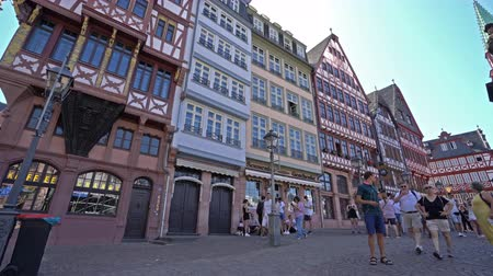 mediaeval : Frankfurt am Main, July 2019. View of people walking in the Rmerberg square Stock Footage