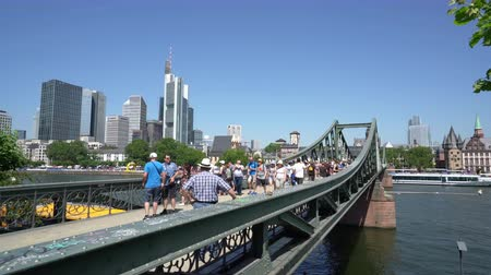 the suspension bridge : Frankfurt am Main, July 2019. A view of the people walking on the iron bridge. Stock Footage