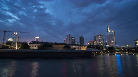 немецкий : Frankfurt, Germany. July 2019. the skyline of the city against the background of the river Main at night Стоковые видеозаписи