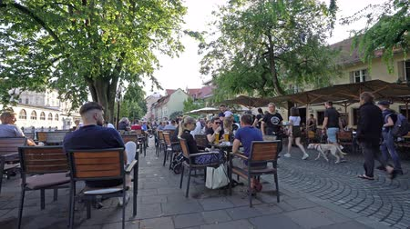 ljubljana : Ljubljana, Slovenia. August 3, 2019. the sight of people in outdoor cafes along the shore of the river Ljubljanica in the city center