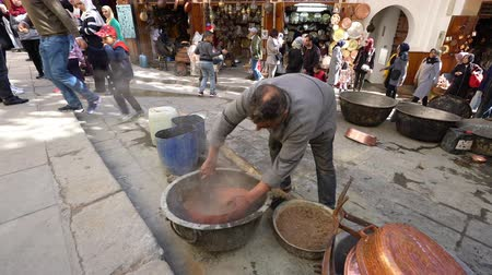 медь : Fez, Morocco. November 9, 2019. View of the local traditional manual processing of metal pots