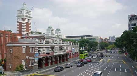 architectural heritage : Singapore, January 2020. Time lapse view of the building the fire station in the city center Stock Footage