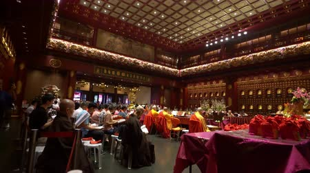 fiel : Singapore. January 2020. The faithful pray in Buddha Tooth Relic Temple