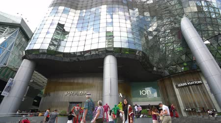 glass structure : Singapore, January 2020. the people in front of the stores outdoor of ION Orchard shopping mall entrance