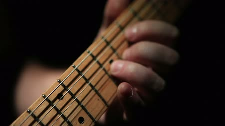 жить : Closeup shot of guitar fretboard while solo being played