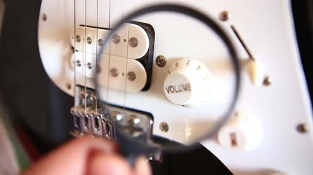yinyang : Inspecting Electric Guitar Details Over Magnivying Glass HD