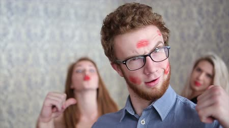 ruj : Lucky Guy Covered in Kisses by Beautiful Young Girls on Light Background Slowmotion