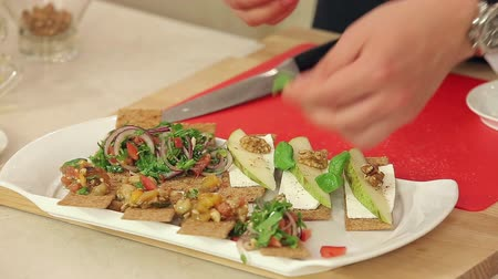 crostini : Chef is Making Bruschettas with Vegetable Mix, Pears and Nuts HD
