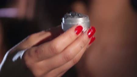 lakier do paznokci : Silver Tinsel Blown off Female Hand with Red Nails HD