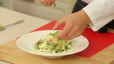 ocet : Chef is cooking hot vegetable salad Wideo