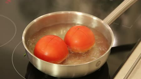 blanching : Blanching tomatoes in a stewpan
