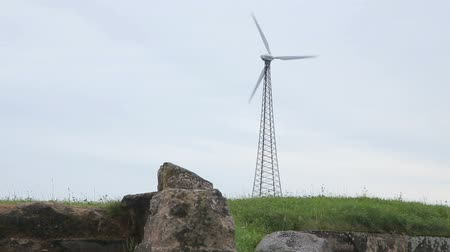 abandonment : Ruins and wind turbine in the field Stock Footage