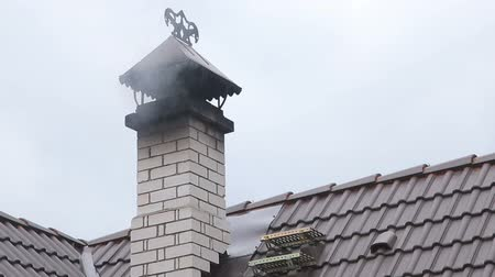 tin roofs : Smoke out of the chimney