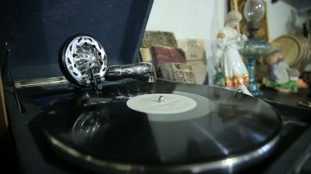 rock album : Old gramophone playing vinyl record Stock Footage