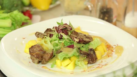beef dishes : Salad with chicken liver and mango Stock Footage