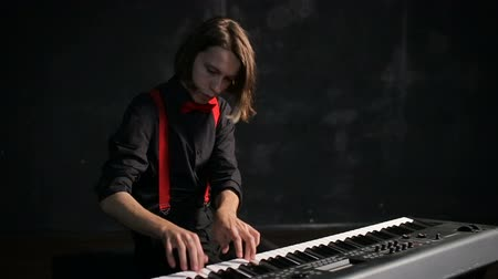 Young male musician playing piano
