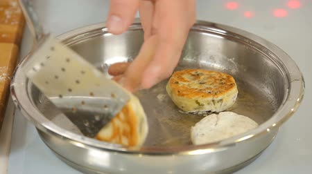 jewish : Cooking homemade potato pancakes