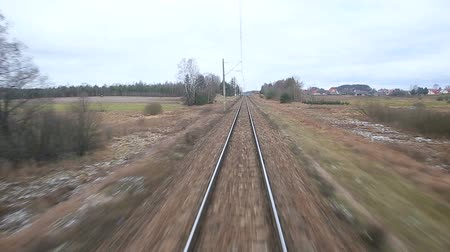 Railroad track running through coutry landscapes Wideo