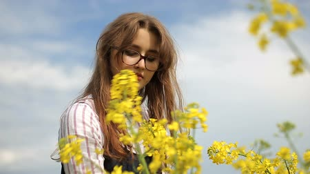 Teenage girl picking flowers in the field