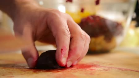 cutted : Cutting boiled beetroot on a wooden board Stock Footage