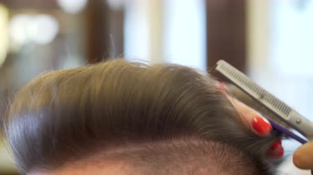 barber scissors : Young man getting haircut Stock Footage