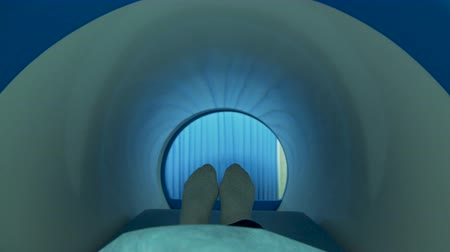 radiation therapy : A patient moving into mri scan machine Stock Footage