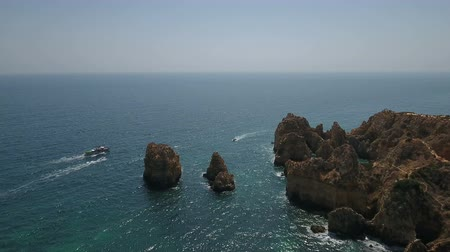 ponta da piedade : Aerial. Ponta de Piedade flying over the cliffs and caves.