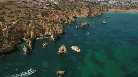 ponta da piedade : Aerial. Flying drones over the beaches and caves, the Bay Ponta de Piedade.