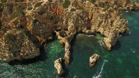 ponta da piedade : Aerial. Details of the sky, the rocks the Bay Ponta de Piedade. Stock Footage