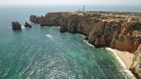 ponta da piedade : Aerial. Cape Lighthouse Ponta da Piedade shot in the air video. Stock Footage