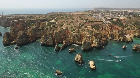 ponta da piedade : Aerial. Cape air video Ponta de Piedade, boat with tourists on the sea. Stock Footage