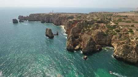 ponta da piedade : Aerial. Kayaks with tourists near Cape Ponta de Piedade. Stock Footage
