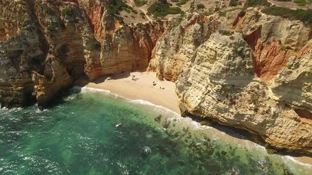 ponta da piedade : Aerial. Tourists on the small beach of the Gulf Ponta de Piedade, taken from the sky. Stock Footage
