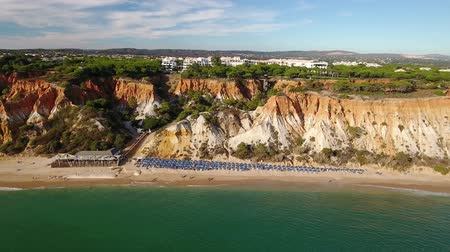 agua : Aerial. Shores Olhos de Agua view from sky. Albufeira Stock Footage