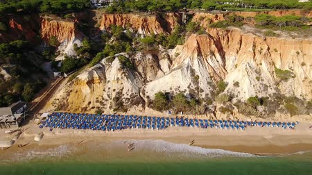 agua : Aerial. Coast and sandy mountains Olhos de Agua view from sky. Albufeira Stock Footage