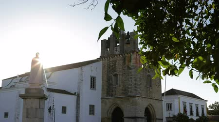 arco : Sunrise over the Church of St. Maria in city of Faro. Algarve Portugal