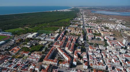 architecture and urbanism : Aerial. Vila Real Santo Antonio and the Praia Verde on the ocean.